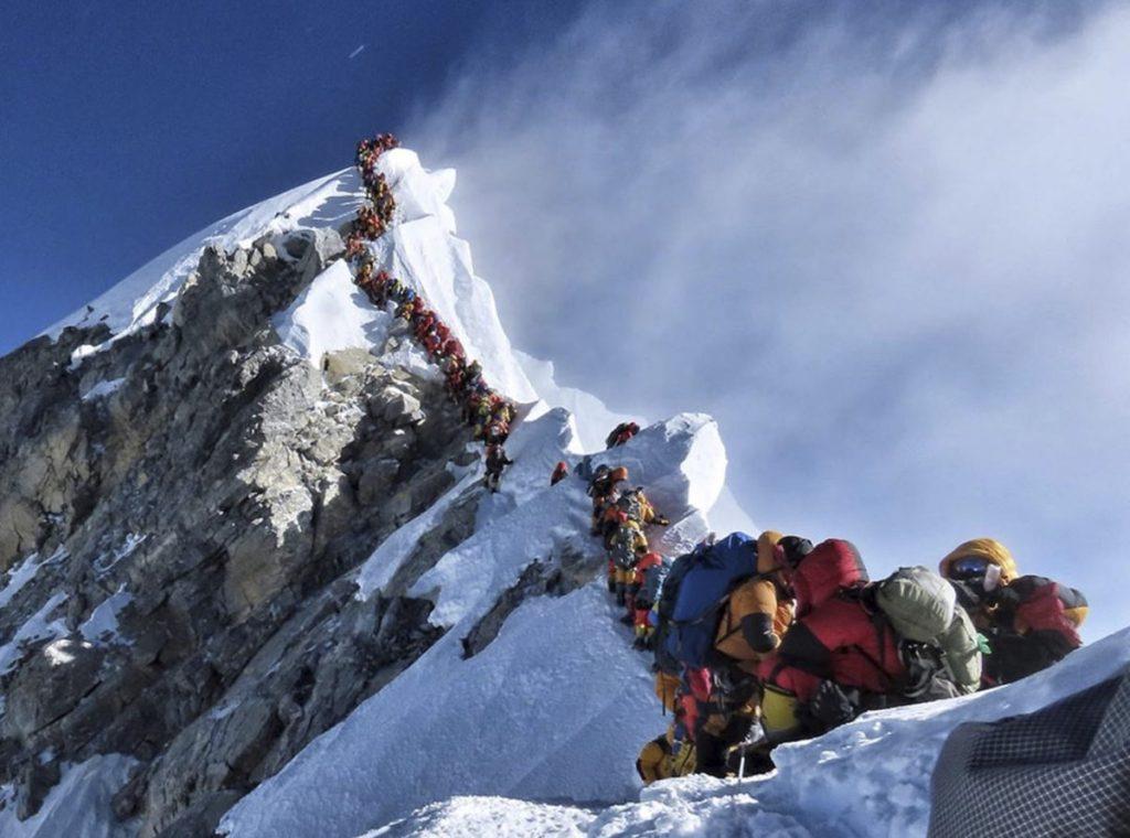 an insane amount of people climbing the ridge up Mt. Everest